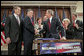 President George W. Bush shakes hands with Congressman Peter King, R-N.Y., chairman of the Homeland Security Committee, after signing H.R. 4954, the SAFE Port Act, in the Dwight D. Eisenhower Executive Office Building Friday, Oct. 13, 2006. Also pictured from left are Sen. Bill Frist, R-Tenn.; Sen. Susan Collins, R-Maine; Sen. Robert Bennett, R-Utah; Sen. Patty Murray, D-Wash.; and Sen. Norm Coleman, R-Minn. White House photo by Paul Morse