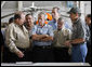 """President George W. Bush meets with local officials at the U.S. Coast Guard facility at Ellington Field in Houston Tuesday, Sept. 16, 2008 before taking an aerial tour of Texas areas damaged in last weekend's hurricane. Said the President afterward, """"My first observation is that the state government and local folks are working very closely and working hard and have put a good response together. The evacuation plan was excellent in its planning and in execution. The rescue plan was very bold, and we owe a debt of gratitude to those who were on the front line pulling people out of harm's way, like the Coast Guard people behind us here.""""  White House photo by Eric Draper"""