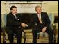President George W. Bush meets with Tunisian President Zine Al-Abidine Ben Ali in the Oval Office Wednesday, February 18, 2004.  White House photo by Paul Morse