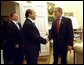 President George W. Bush greets Russian Foreign Minister Igor Ivanov, center, and Russian Defense Minister Sergei Ivanov, left, as they walk into the Oval Office, Friday, Sept. 20, 2002.
