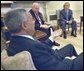 Secretary Colin Powell briefs President George W. Bush and Vice President Dick Cheney in the Oval Office, Thursday, Sept 19, on the progress of working with the United Nations, to convince the United Nations Security Council to deal with a threat to world peace.