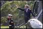 President George W. Bush waves as he prepares to depart the White House aboard Marine One from the South Lawn en route to Andrews AFB for his trip to Michigan, Friday, Sept. 8, 2006.  White House photo by Eric Draper