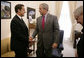 President George W. Bush drops by a meeting between National Security Advisor Stephen Hadley and France's Minister of the Interior and Regional Development Nicolas Sarkozy at the White House Tuesday, Sept. 12, 2006. White House photo by Kimberlee Hewitt