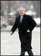 President George W. Bush makes his way across the South Lawn after arriving at the White House aboard Marine One from his weekend at Camp David, Md., Monday, Jan. 22, 2007. The President spent the weekend at the Presidential retreat preparing for his State of the Union address to be delivered before Congress Tuesday evening. White House photo by Paul Morse