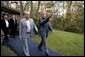 President George W. Bush escorts President Vladimir Putin of Russia after his arrival at Camp David, Friday, Sept. 26, 2003. White House photo by Eric Draper
