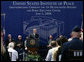 President George W. Bush addresses the audience during groundbreaking ceremonies Thursday, June 5, 2008, for the United States Institute of Peace Headquarters Building and Public Education Center at Navy Hill in Washington, D.C. The U.S. Institute of Peace is a congressionally funded foreign affairs education, training and operational organization.  White House photo by Chris Greenberg