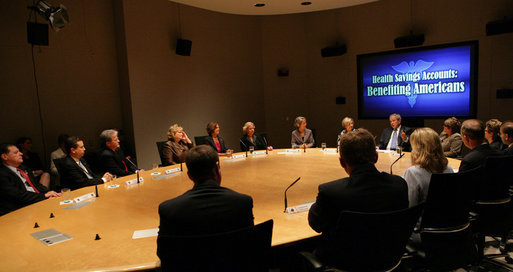 "President George W. Bush participates in a roundtable discussion on Health Savings Accounts Friday Sept. 12, 2008, at the Presbyterian Health Foundation Conference Center in Oklahoma City. Said the President afterward, ""I do want to thank you all very much for, one, being pioneers; two, being risk-takers; and three, giving me a chance to hear your thoughts and concerns and -- about a very innovative way for small businesses and individuals to be able to better afford health care."" White House photo by Chris Greenberg"