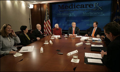 President George W. Bush participates in a roundtable discussion on Medicare Friday, Oct. 20, 2006 at the Department of Health and Human Services in Washington, D.C. Participants included Dr. William Hardison and wife, Lois, seated to the President's left, a retired couple from Springfield, Va., who receive Medicare and estimate they've saved more than $1,000 so far this year with the Part D Plan. White House photo by Kimberlee Hewitt
