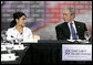 President George W. Bush speaks with Esmerelda Wergin, who works as a waitress in Overland Park, Mo., about how hard it is to maintain insurance for her family during a roundtable discussion on health care initiatives at the Saint Luke's-Lee's Summit hospital in Lee's Summit, Mo., Thursday, Jan 25, 2007. Under the new health care initiatives offered in President Bush's State of the Union address, Wergin would save over two thousand dollars, making insurance for her family more attainable. White House photo by Eric Draper