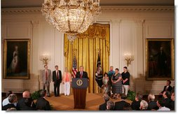 """President George W. Bush, joined by families who were aided by the use of adult stem cells in their health treatments, addresses his remarks concerning his veto of S.5, the """"Stem Cell Research Enhancement Act of 2007,"""" in the East Room of the White House Wednesday, June 20, 2007.  White House photo by Joyce N. Boghosian"""