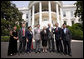 President George W. Bush poses for a photo at the South Portico entrance to the White House Tuesday, July 29, 2008, with Chinese Human Rights Activists, from left, Ciping Huang, Wei Jingsheng, Sasha Gong, Alim Seytoff, interpreter; Rebiya Kadeer, Harry Wu and Bob Fu, following their meeting at the White House. White House photo by Eric Draper