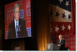 President George W. Bush is seen on a large video screen as he addresses his remarks to guests Wednesday evening, Oct. 1, 2008, at the United Services Organization World Gala in Washington, D.C. White House photo by Chris Greenberg