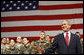 President George W. Bush waves to the crowd after arriving on stage Monday, Aug. 4, 2008, at Eielson Air Force Base, Alaska, where he addressed military personnel before continuing on to South Korea. White House photo by Eric Draper