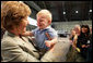 Mrs. Laura Bush receives a smile from a young boy as she greets the audience Monday, Aug. 4, 2008, after remarks by the President at Eielson Air Force Base, Alaska, their first stop en route to Asia. White House photo by Shealah Craighead