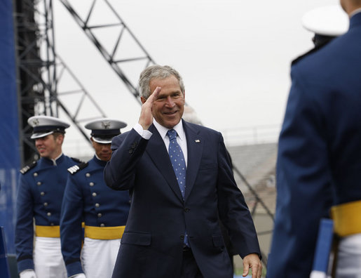 "President George W. Bush salutes a graduate of the United States Air Force Academy during commencement exercises Wednesday, May 28, 2008, in Colorado Springs. Speaking to the 1,012 graduating cadets, the President said, ""Each of you gathered here this morning has answered that same call. I want to thank you for stepping forward to serve. The security of our citizens and the peace of the world will soon be in your hands -- the best of hands. Be officers of character and integrity. Keep your wings level and true. Never falter; do not fail. And always know that America stands behind you."" White House photo by Eric Draper"