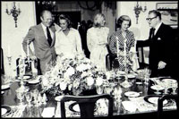 Then-Vice President Nelson Rockefeller (right) and his wife Margaretta Murphy (second on right) entertain then-President Gerald R. Ford (left) his wife Betty (second on left) and their daughter Susan (center) at the Naval Observatory on September 7, 1975.