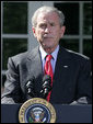 """President George W. Bush pauses as he delivers a statement on the Emergency Economic Stabilization Act of 2008 Friday, Oct. 3, 2008, in the Rose Garden of the White House. Said the President, """"There were moments this week when some thought the federal government could not rise to the challenge. But thanks to the hard work of members of both parties in both Houses -- and a spirit of cooperation between Capitol Hill and my administration -- we completed this bill in a timely manner."""" White House photo by Joyce N. Boghosian"""