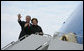 President George W. Bush and Mrs. Laura Bush wave from Air Force One as they board the aircraft Friday, Feb. 15, 2008, at Andrews Air Force Base en route to Benin, the first stop on their five-country, African visit. White House photo by Chris Greenberg