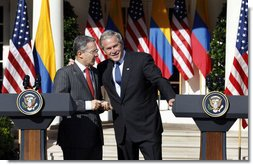 President George W. Bush talks with Colombian President Alvaro Uribe following a joint press availability Saturday, Sept. 20, 2008, in the Rose Garden at the White House.  White House photo by Eric Draper