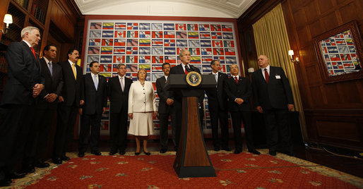 """President George W. Bush is surrounded by leaders from the Western Hemisphere as he delivers a statement on free trade Wednesday, Sept. 24, 2008, at the Council of the Americas in New York City. Said the President, """"Each of the 11 countries here has a free trade agreement with the United States, or one pending before Congress. Free and fair trade is in our mutual interests."""" White House photo by Eric Draper"""