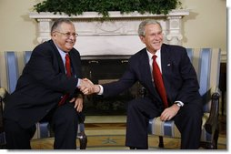 President George W. Bush welcomes Iraqi President Jalal Talabani to the Oval Office, Wednesday, Sept. 10, 2008, where the two leaders heralded the improved security situation and quality of life for the citizens of Iraq.  White House photo by Eric Draper