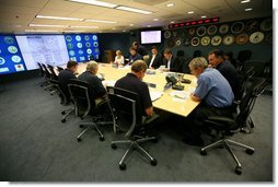 President George W. Bush, joined by Federal Emergency Management Agency Administrator David Paulison, right, and Deputy Administrator Harvey Johnson, left, participates in a briefing on preparations for Hurricane Gustav, at the FEMA National Response Center, Sunday, August 31, 2008 in Washington, DC. White House photo by Chris Greenberg