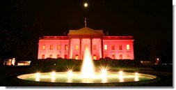 Floodlights turned the north side of the the White House pink on the evening of Oct. 7, 2008 to raise awareness about breast cancer. The unique view of the North Portico facing Lafayette Park was to observe Breast Cancer Awareness Month. Breast cancer awareness is a cause for which Mrs. Laura Bush has worked to motivate both public and private sectors, worldwide, as as she has encouraged collaborative research to find a cure. The World Health Organization says each year more than 1.2 million people worldwide are diagnosed with it and breast cancer is one of the leading causes of death for women. White House photo by Grant Miller