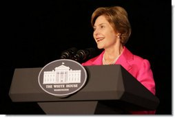 Mrs. Bush addresses a group gathered for the lighting of the White House, Oct. 7, 2008, in the color pink in honor of Breast Cancer Awareness Month. Mrs. Bush thanked the researchers, doctors, advocates and others who have worked to fight the disease that is the leading cause of death in women. Mrs. Bush has worked to make the fight on cancer and cancer prevention a global effort.  White House photo by Chris Greenberg