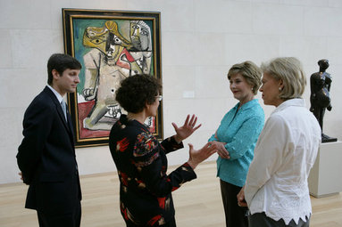 Mrs. Laura Bush stops in front of Pablo Picasso's painting 'Nude Man and Woman' as she is given a tour of the Nasher Sculpture Center by Acting Chief Curator Jed Morse, left, Trustee Nancy Nasher, gesturing, and Debbie Francis, right, Friday, Sept. 19, 2008 , in Dallas. White House photo by Chris Greenberg