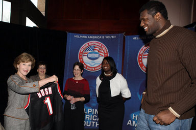 Mrs. Laura Bush holds an National Basketball Association basketball jersey presented to her by NBA player Mr. Greg Oden of the Portland Trail Blazers, during the regional conference on Helping America's Youth at the Portland Center for the Performing Arts in Portland, Ore. Also attending the presentation are, from left, Ms. Robyn Williams, executive director, Portland Center for the Performing Arts; Mrs. Mary Oberst, first lady of Oregon; and student, Ms. Shantel Monk. White House photo by Shealah Craighead
