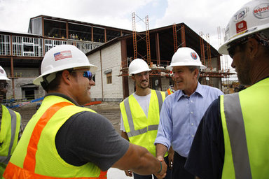 President George W. Bush meets with construction workers on his tour Wednesday, Aug. 20, 2008 of the historic Jackson Barracks of New Orleans, headquarters of the Louisiana National Guard. The barracks were seriously damaged in 2005 by Hurricane Katrina. White House photo by Eric Draper