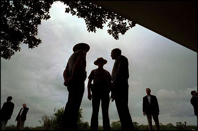 President George W. Bush talks with national park service officers at the Royal Palm Visitors Center at Everglades National Park, Fla., June 4, 2001. White House photo by Eric Draper.