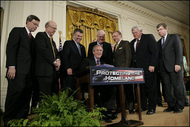 President George W. Bush is joined by House and Senate representatives as he signs H.R. 3199, USA Patriot Improvement and Reauthorization Act of 2005.