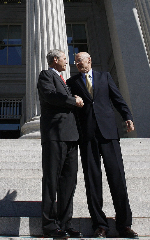 """President George W. Bush shakes hands with Secretary Hank Paulson of the U.S. Department of Treasury after visiting the department Friday, Oct. 3, 2008. Said the President upon his departure, """"Mr. Secretary, you and your team have worked incredibly hard. You've worked with the Congress; you've worked with the financial markets, both domestically and internationally. I know that your people are exhausted in there, and I really appreciate the fact that I'll be signing a piece of legislation that will be a part of solving this crisis, an important part of solving the crisis."""" White House photo by Eric Draper"""