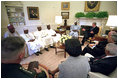 President George W. Bush meets with President Olusegun Obasanjo of Nigeria in the Oval Office May 11, 2001. President Bush and President Obasanjo discussed the need for peacekeeping training of African troops.