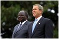 Presidents Bush and Kibaki watch the military review portion of the State Arrival Ceremonies on the South Lawn of the White House Monday, October 5, 2003.