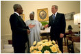 President George W. Bush hosts a visit by United Nations Secretary General Kofi Annan and Nigerian President Olusegun Obasanjo to the Oval Office May 11, 2001. President Bush discussed a strategy to halt the spread of AIDS and other infectious diseases across the African continent and the world. President Bush pledged U.S. support for the Global HIV/AIDS fund and jump-started the fund with the first contribution. The United States is the largest major contributor to the fund, which has now reached $500 million.