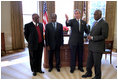 President George W. Bush hosts President Festus Gontebanye Mogae of Botswana, President Joaquim Albetto Chissano of Mozambique and President Jose Eduardo dos Santos of Angola in the Oval Office Feb. 26. 2002. The four presidents discussed their common interests to work bilaterally and through the Southern Africa Development Community to bring greater peace and stability to the region. President Bush encouraged President dos Santos to end 26 years of civil war in Angola and welcomed dos Santos' pledge to move quickly to achieve a cease-fire and normalization of politics in Angola.