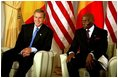 President George W. Bush meets with President Abdoulaye Wade of Senegal at the Presidential Palace in Dakar, Senegal, Tuesday morning, July 8, 2003.