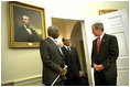 President George W. Bush welcomes President Daniel arap Moi of Kenya and Prime Minister Meles Zenawi of Ethiopia to the Oval Office Dec. 5, 2002. These leaders, who are friends and allies of America, have joined in global war on terror. President Bush stressed the global reach of the war and noted that if the terrorists could strike in Kenya, they could strike in Ethiopia or anywhere.