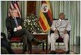 President George W. Bush meets with President Yoweri Museveni of Uganda Friday, July 11, 2003 in Entebbe, Uganda.