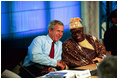President George W. Bush talks with President Olusegun Obasanjo of Nigeria during a G8 Summit working session in Evian, France, June 1, 2003. The G8 leaders and the leaders of the New Partnership for Africa's Development (NEPAD) highlighted greater cooperation between the G8 and NEPAD and discussed challenges and opportunities going forward. President Bush and President Obasanjo are working together to forge an African Action Plan that removes obstacles of trade barriers, illiteracy, infectious disease, unsustainable debt and hunger. President Bush and President Obasanjo agreed that such a partnership must be based on mutual respect and responsibility.