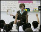 Mrs. Laura Bush talks with first grade students about Malaria Awareness Day and the book 'Nets are Nice,' during her visit Wednesday, April 25, 2007 to the Friendship Public Charter School on the Woodridge Elementary and Middle School campus in Washington, D.C. White House photo by Shealah Craighead