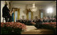 President George W. Bush is joined by Spain's Crown Prince Felipe de Borbon y Grecia, seated left, as they applaud the performance of singer Ana Cristina and guitarist Marco Linares, Friday, Oct. 6, 2006, in the East Room of the White House, in celebration of Hispanic Heritage Month. White House photo by Kimberlee Hewitt