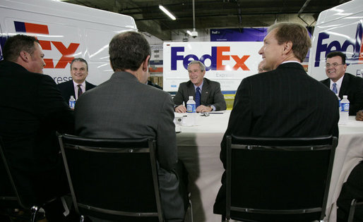 President George W. Bush meets with business leaders Friday, Oct. 6, 2006, at the FedEx Express DCA Facility in Washington, D.C., during a roundtable discussion on job growth and the economy. President Bush was joined at the meeting by U.S. Secretary of the Treasury Henry Paulson and Al Hubbard, Assistant to the President for Economic Policy. White House photo by Kimberlee Hewitt