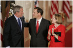 President George W. Bush, Thursday, Sept. 29, 2005 in the East Room of the White House in Washington, congratulates Chief Justice John G. Roberts and his wife Jane, after he is sworn-in as the 17th Chief Justice of the United States.