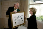 Mrs. Lynne Cheney is presented the National Society of the Sons of the American Revolution (NSSAR) Distinguished Patriot Award by Timothy R. Bennett, NSSAR Registrar General, Wednesday, July 30, 2008, at the Vice President's Residence at the Naval Observatory in Washington, D.C.