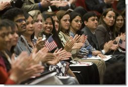 Arlene Oftedahl of Burke, Va., center, is all smiles as she and some of America's newest citizens applaud Mrs. Cheney as she delivers her remarks during a special naturalization ceremony at the National Archives Tuesday, April 17, 2007, in Washington, D.C.