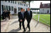 President George W. Bush and President Nicolas Sarkozy of France walk a path from George Washington's mansion during their tour Wednesday, Nov. 7, 2007, of the first president's home.