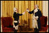 General George Washington (played by Dean Malissa) and General Marie Joseph Paul Yves Roch Gilbert du Motier, the Marquis de LaFayette (played by Benjamin Goldman), toast each other at the beginning of their dialogue Tuesday, Nov. 6, 2007, during the entertainment in the East Room following a dinner in honor of President Nicolas Sarkozy at the White House.